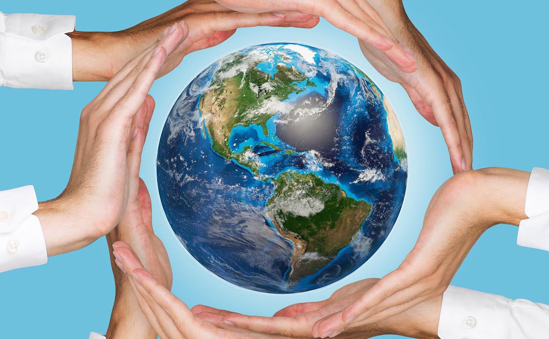 Hands circling globe